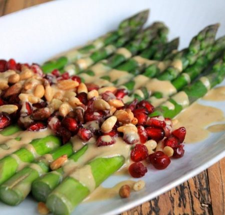 Asparagus Salad with Pomegranate, Toasted Pine Nuts and a Tahini-Lime Sauce